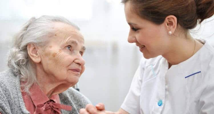 a home health nurse caring for a patient