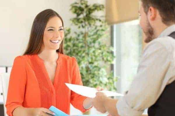 a nurse interviewing and asking questions