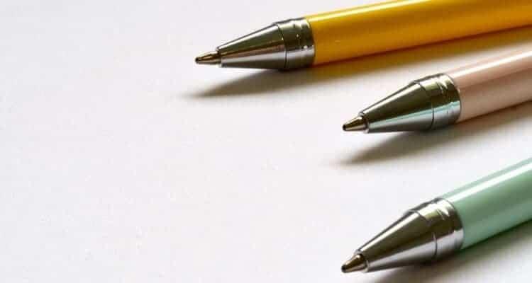 yellow and green top nurse pens