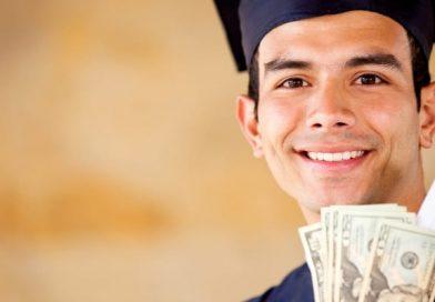 a nursing school grad holding money