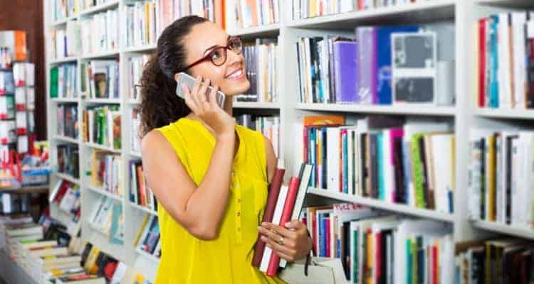 woman looking for book in bookstore