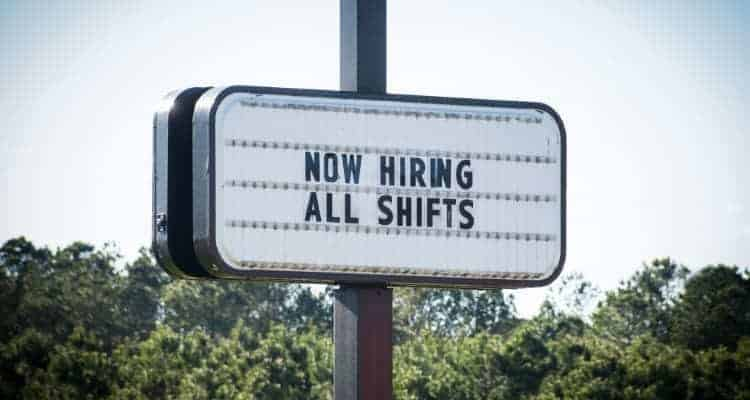 a sign that says now hiring all shifts