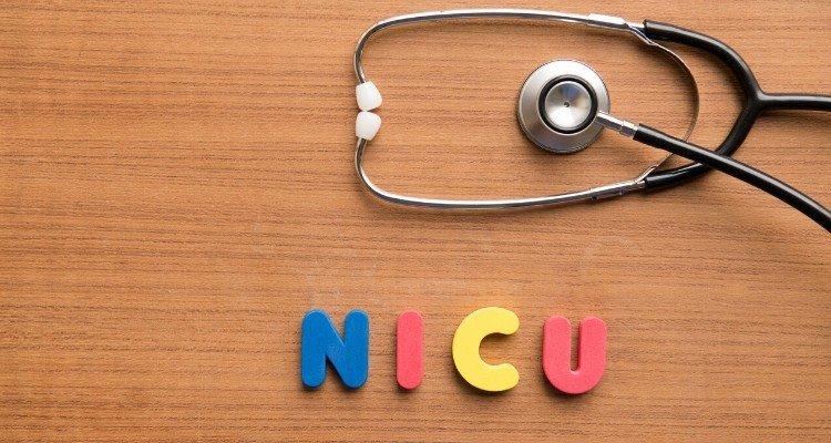 a stethoscope next to words NICU