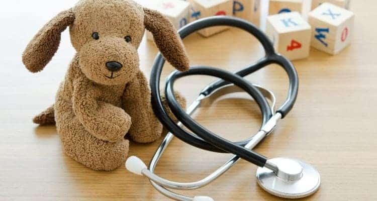 a pediatric nurse stethoscope and a stuffed bear