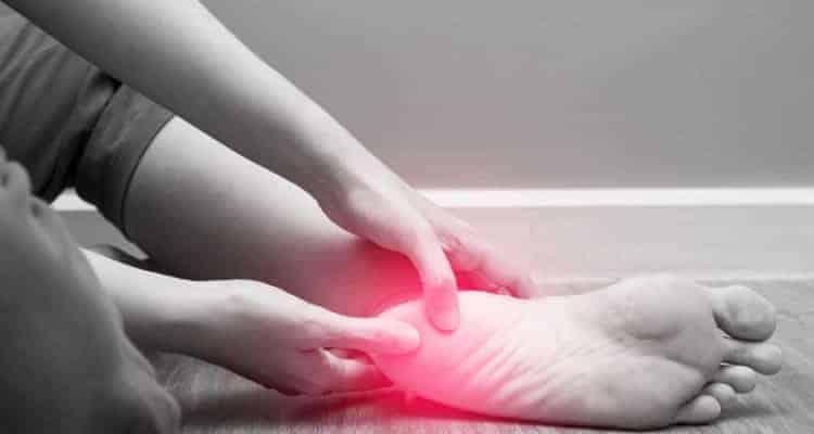 a nurse rubbing the bottom of her heel