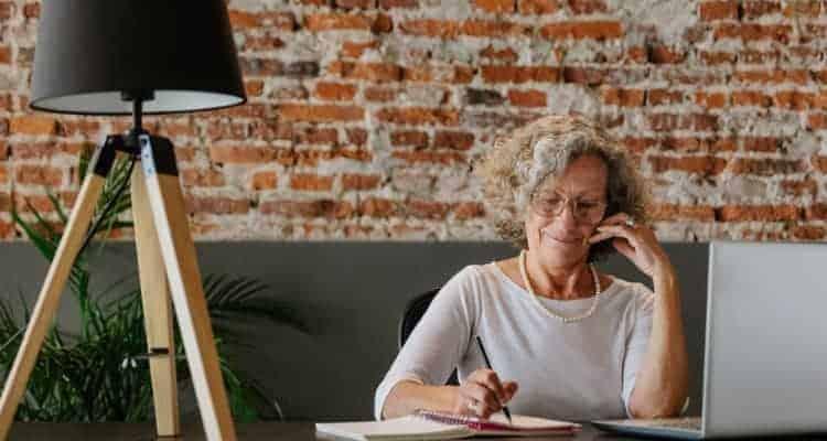 older woman studying for nursing school