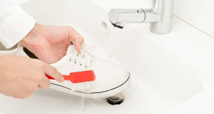 a nurse cleaning her shoe