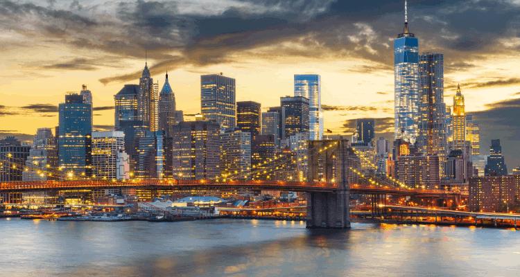 City lights and bridge in New York City, NY