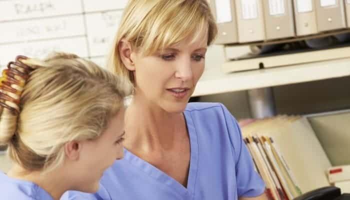 a nurse preceptor talking to new nurse