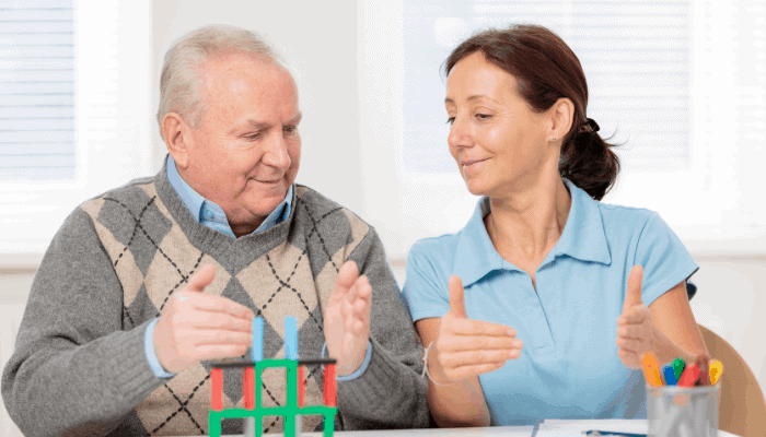 an OT working with an adult patient